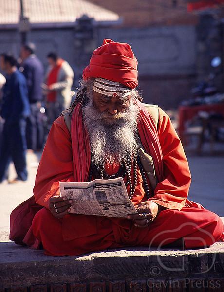 Newspaper_Reader_in_Kathmandu.jpg