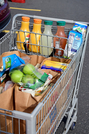 3/21/2020 Mike Orazzi | Staff A shopper's cart at the Price Chopper in Bristol on Saturday morning.