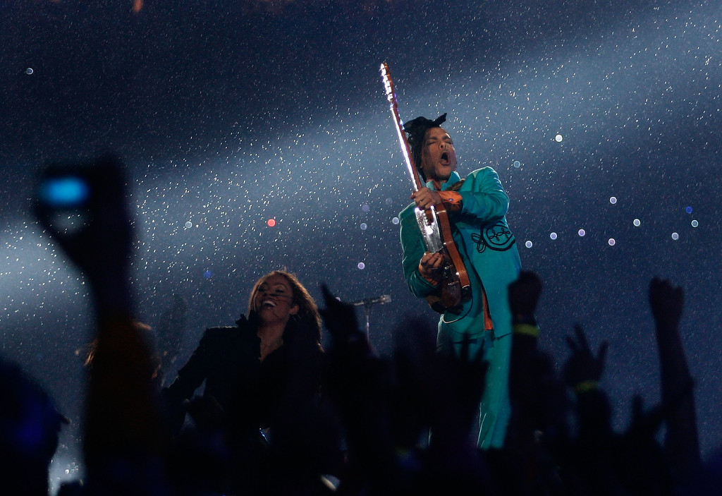 ". Prince performs during the ""Pepsi Halftime Show\"" at Super Bowl XLI between the Indianapolis Colts and the Chicago Bears on February 4, 2007 at Dolphin Stadium in Miami Gardens, Florida.  (Photo by Donald Miralle/Getty Images)"