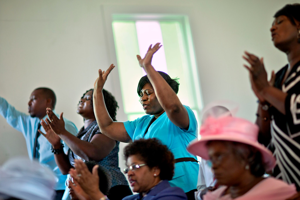 . Donna Smith, a resident from the mainland who came over by ferry to attend the 129th anniversary of St. Luke Baptist Church, sings during the church\'s service on Sapelo Island, Ga. on Sunday, June 9, 2013. (AP Photo/David Goldman)
