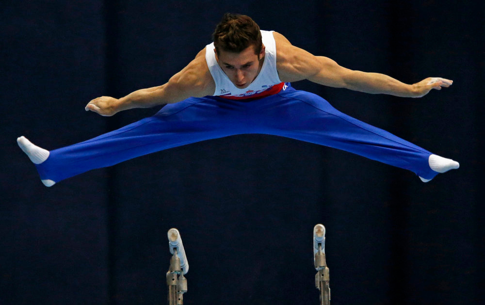 . Russia\'s David Belyavskiy competes on the parallel bars during the men\'s apparatus finals at the European Men\'s and Women\'s Artistic Gymnastic individual Championships in Moscow April 21, 2013.  REUTERS/Grigory Dukor