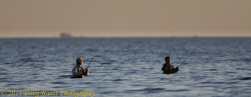 Wade fishermen at sunrise