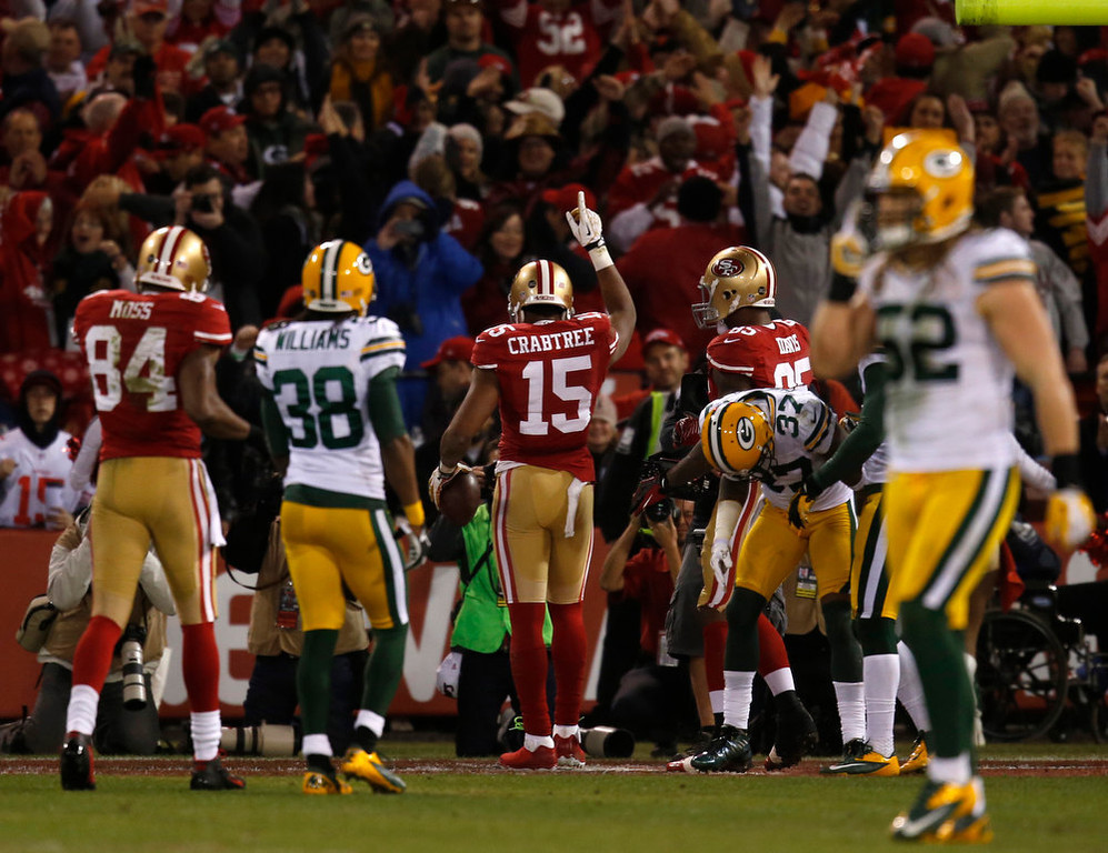 . San Francisco 49ers wide receiver Michael Crabtree (15) celebrates his touchdown against the Green Bay Packers in the first quarter in the NFC Divisional Playoff on Saturday, January 12, 2013, at Candlestick Park in San Francisco, California. (Nhat V. Meyer/San Jose Mercury News)