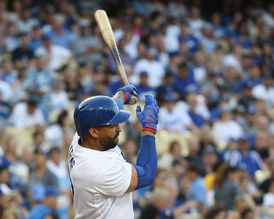 . Matt Kemp #27 of the Los Angeles Dodgers singles to center and drives in a run in the first inning during the MLB game against the Colorado Rockies at Dodger Stadium on June 18, 2014 in Los Angeles, California.  (Photo by Victor Decolongon/Getty Images)