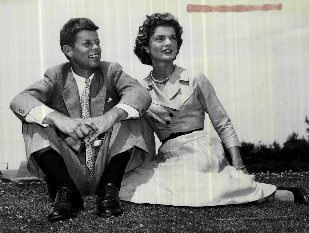 . Sen. Kennedy and his bride, the former Jacqueline Bouvier, relax on a Cape Cod dune on Nov.  6, 1953.  A Washington socialite, Jacqueline had a brief journalistic experience as a photographer.