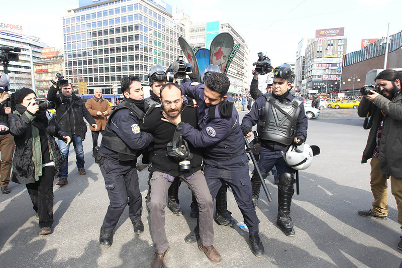 . An anti-government protester is detained by riot policemen during a protest rally to mark the funeral of Berkin Elvan in Ankara on March 12, 2014.  Protestors clashed with police in Turkey on Wednesday as tens of thousands of people took to the streets to mourn a teenage boy who died from injuries suffered during last year\'s anti-government protests. Riot police fired tear gas and water cannon at protestors in the capital Ankara, while in Istanbul, crowds shouting anti-government slogans lit a huge fire as they made their way to a cemetery for the burial of 15-year-old Berkin Elvan. (ADEM ALTAN/AFP/Getty Images)