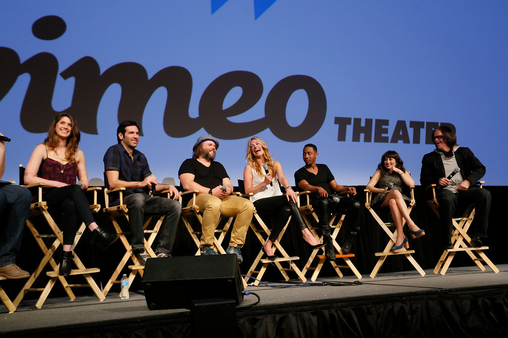 """. Cody Heller, from left, Brett Konner, Tyler Labine, Cat  Deeley, Brandon Jackson, Lucy DeVito and director Troy Miller, from left,discuss their new Hulu series \""""Deadbeat\"""" during the SXSW Film Festival on Tuesday, March 11, 2014, in Austin, Texas. (Photo by Jack Plunkett/Invision/AP)"""