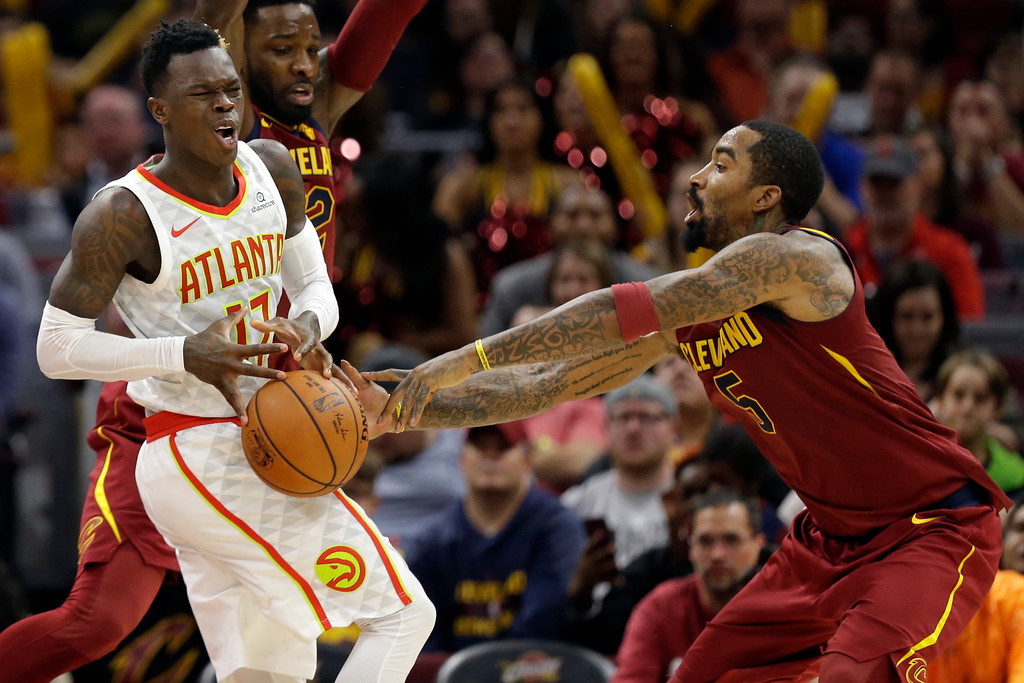 . Cleveland Cavaliers\' JR Smith (5) knocks the ball loose from Atlanta Hawks\' Dennis Schroder (17), from Germany, in the second half of an NBA basketball game, Sunday, Nov. 5, 2017, in Cleveland. (AP Photo/Tony Dejak)