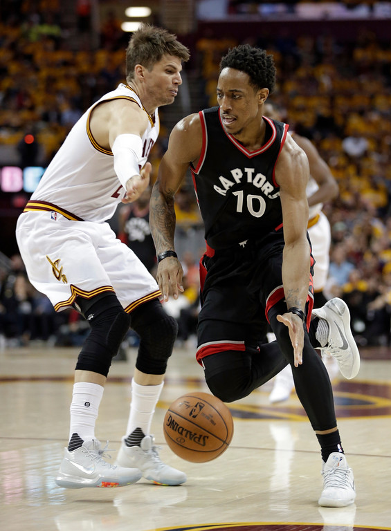 . Toronto Raptors\' DeMar DeRozan (10) drives past Cleveland Cavaliers\' Kyle Korver (26) in the first half in Game 1 of a second-round NBA basketball playoff series, Monday, May 1, 2017, in Cleveland. (AP Photo/Tony Dejak)