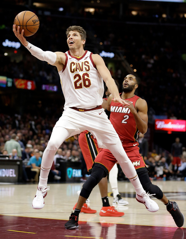 . Cleveland Cavaliers\' Kyle Korver (26) drives to the basket against Miami Heat\'s Wayne Ellington (2) in the first half of an NBA basketball game, Tuesday, Nov. 28, 2017, in Cleveland. (AP Photo/Tony Dejak)