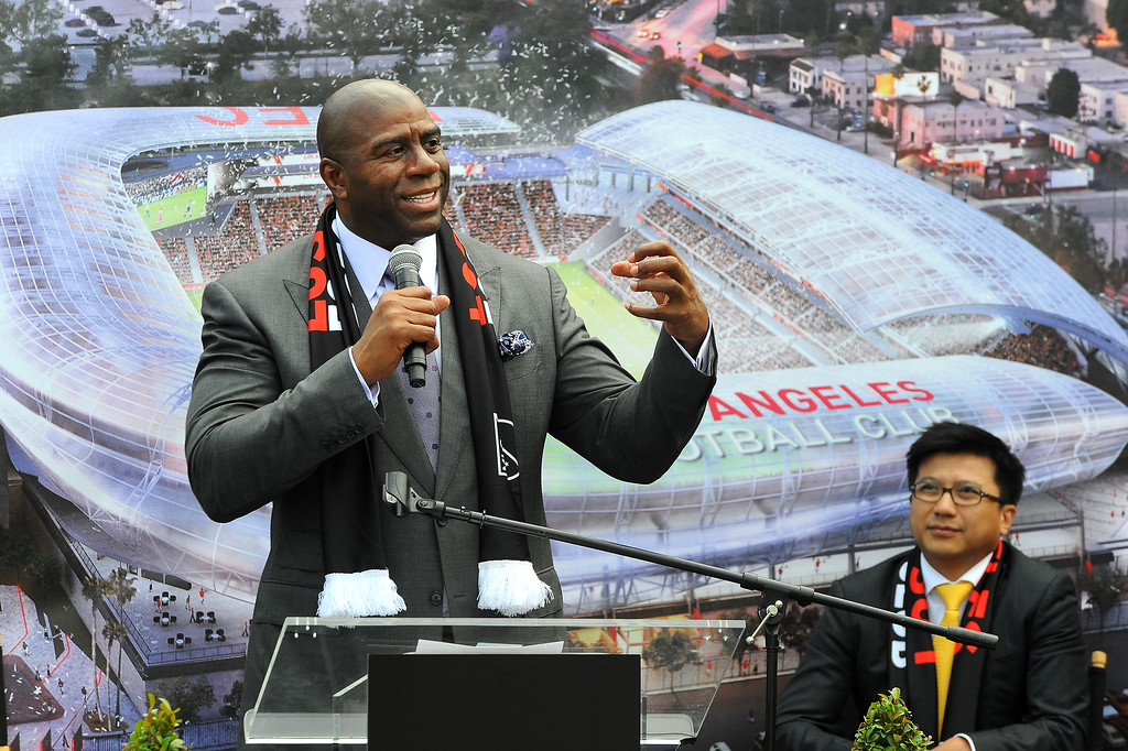 . Earvin \'Magic\' Johnson speaks about the new soccer stadium to be built at the site of the L.A. Sports Arena, Monday, May 18, 2015. Henry Nguyen, head of the Los Angeles Football Club, is in the background. (Photo by Michael Owen Baker/Los Angeles Daily News)