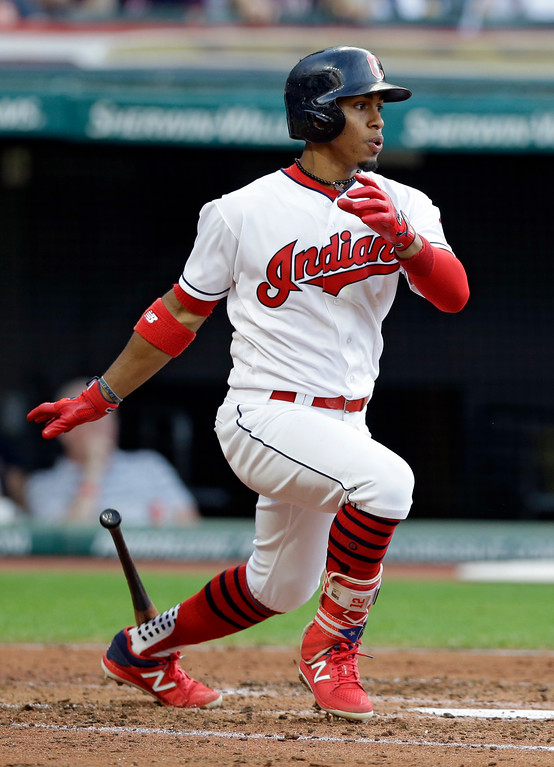 . Cleveland Indians\' Francisco Lindor watches his ball after hitting an RBI-single off San Diego Padres starting pitcher Luis Perdomo in the third inning of a baseball game, Wednesday, July 5, 2017, in Cleveland. Erik Gonzalez scored on the play. (AP Photo/Tony Dejak)