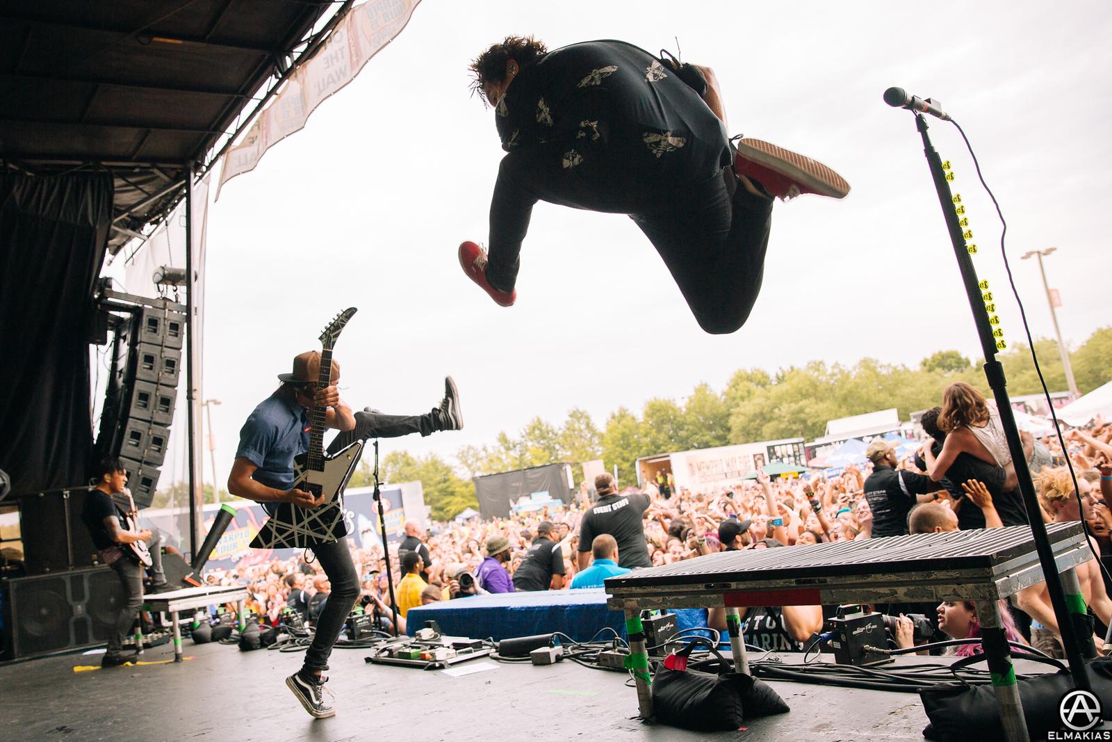 Vic Fuentes and Jaime Preciado of Pierce the Veil live at Warped Tour 2015 by Adam Elmakias