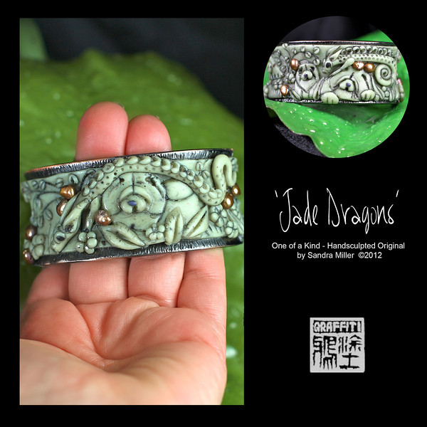 """JADE DRAGONS-CLICK HERE TO VIEW VIDEO DESCRIPTION IN A NEW WINDOW  Exquisite hinged cuff bracelet in Faux Jade  I created JADE DRAGONS to commemorate Chinese New Year 2012-Year of the Dragon!!!  Ever since my 2011 Trunk Show I have received dozens of requests to repeat the elaborate cuff bracelet I made.  I finally found a few of the same high end hinged cuffs and am pleased to offer 3 different designs at this 2012 Show  The foundation for the bracelet as I mentioned is a sturdy, slightly oval shaped hinged cuff which stays very securely closed with pressure from the spring hinge on one side.  The finish is a richly textured dark gunmetal grey.  The oval shape stays in place without flipping on the wrist much better than a round cuff.  To this exquisite blank """"canvas"""" I added  THREE handsculpted and carved polymer clay Chow nestled in an Oriental Rock Garden in the softly conceived recess of the bracelet .  The scene completely surrounds the entire surface of the bracelet!! 2 highly detailed dragons weave their way in and out of the garden, greeting the chows with their undulating Dragon Dance.     A little pagoda is on one side and weeping cherry trees arc behind the foreground design.  Real freshwater pearls from my Vietnam trip, in an antiqued gold tone stud both sides of the bracelet!!!   The FAUX JADE I create from polymer clay which was painstakingly layered, thinly sliced and layered again and again to bring out the perfect stonelike striations and translucent quality  of this precious stone!!!   After firing , the entire pendant was covered in black paint (always a """"cringe"""" moment ) and baked on , followed by hours of sanding and buffing off the paint to reveal the exquisite details of the sculpting beneath. It looks for all the world like carved jade without the weight or high price tag of the real deal!!      STRONG HINGED OVAL CUFF  Fits small to medium wrist INSIDE CIRCUMFERENCE   7 1/2"""" closed INSIDE OVAL DIMENSIONS   2 1/4"""" X 2 1/2""""  CUFF MEASURES 1 1"""
