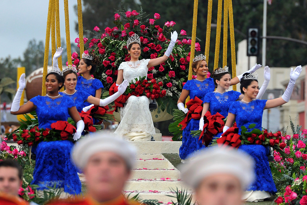 . The Royal Court, clockwise from front left, Princess Shannon Larsuel, Princess Natalie Petrosian, Princess Maya Kawaguchi Khan, Queen Victoria Castellanos, Princess Audrey Cameron, Princess Autumn Lundy and Princess Lauren Emiko Powers, wave to the crowd at the 128th Rose Parade in Pasadena, Calif., Monday, Jan. 2, 2017. (AP Photo/Michael Owen Baker)