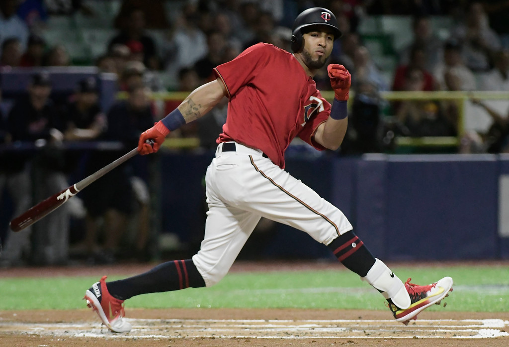 . Minnesota Twins outfielder Eddie Rosario fouls off a pitch during the first inning of game one of a two-game MLB Series against the Cincinnati Indians at Hiram Bithorn Stadium in San Juan, Puerto Rico, Tuesday, April 17, 2018. (AP Photo/Carlos Giusti)