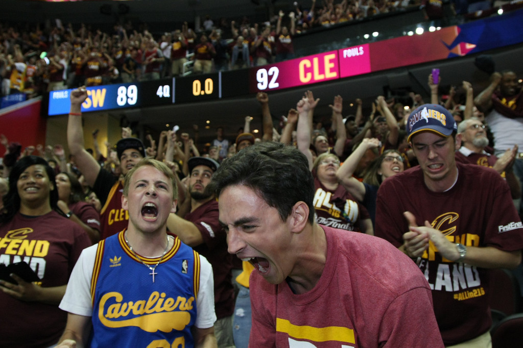 . Cavaliers fans celebrate the Cavs\' 93-89 victory over the Golden State Warriors to become NBA Champions at the Cavs Watch Party at the Quicken Loans Arena on June 19. (Michael Johnson - The News-Herald)
