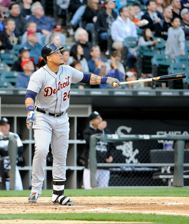 . Detroit Tigers\' Miguel Cabrera watches his two-run home run against the Chicago White Sox during the fifth inning of a baseball game, Saturday, June 6, 2015, in Chicago. (AP Photo/David Banks)