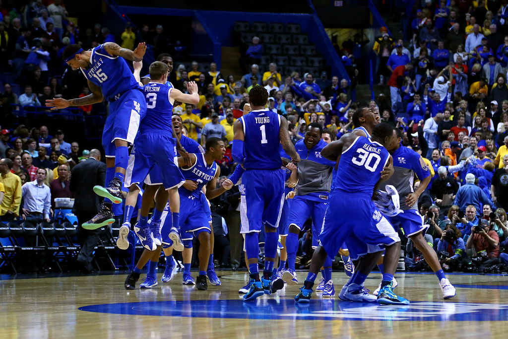 . The Kentucky Wildcats celebrate defeating the Wichita State Shockers 78 to 76 during the third round of the 2014 NCAA Men\'s Basketball Tournament at Scottrade Center on March 23, 2014 in St Louis, Missouri.  (Photo by Dilip Vishwanat/Getty Images)