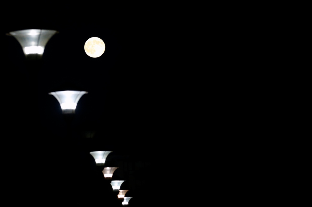 ". A perigee moon, also known as a supermoon, is seen behind a lanterns, in Belgrade, Serbia, Saturday, July 12, 2014. The phenomenon, which scientists call a ""perigee moon,\"" occurs when the moon is near the horizon and appears larger and brighter than other full moons. (AP Photo/Darko Vojinovic)"