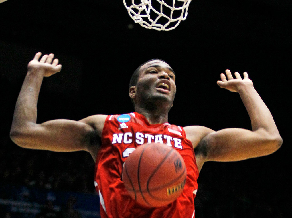 . North Carolina State forward T.J. Warren dunks against Xavier in the first half of a first-round game of the NCAA college basketball tournament, Tuesday, March 18, 2014, in Dayton, Ohio. (AP Photo/Skip Peterson)