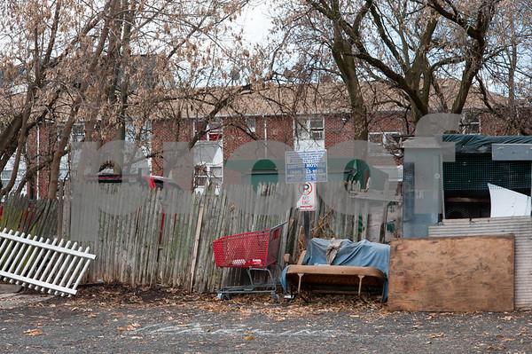 12/06/17 Wesley Bunnell   Staff Trash and other items behind 116 West Street in the North Oak Section of New Britain which was the scene of a fire in February 2017. Residents of the neighborhood have recently been speaking up regarding blight and alleged neglect from the city regarding their concerns.