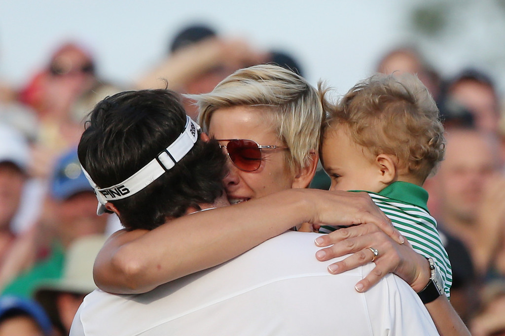 . Bubba Watson of the United States celebrates with his wife Angie and their son Caleb on the 18th green after winning the 2014 Masters Tournament by a three-stroke margin at Augusta National Golf Club on April 13, 2014 in Augusta, Georgia.  (Photo by Andrew Redington/Getty Images)