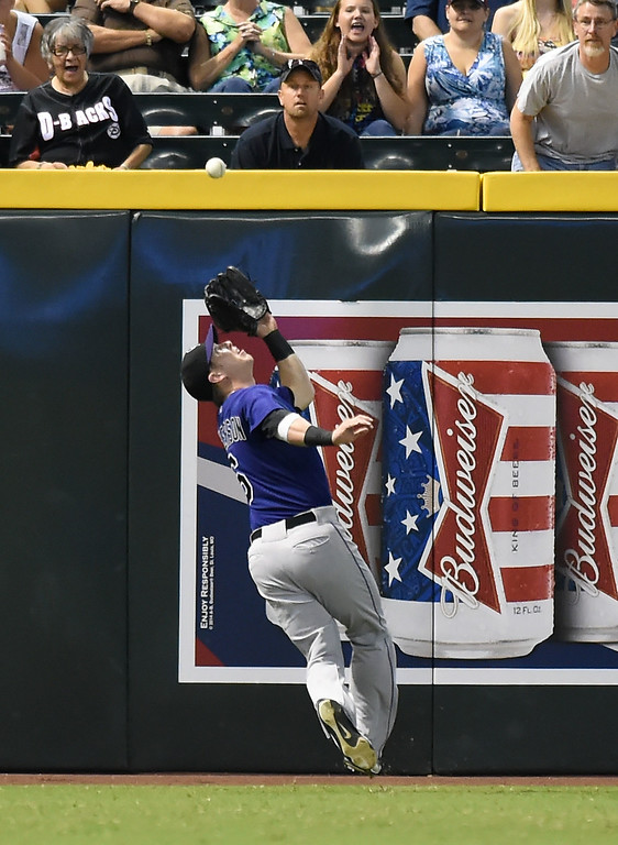 . Corey Dickerson #6 of the Colorado Rockies makes a running catch during the first inning against the Arizona Diamondbacks at Chase Field on August 8, 2014 in Phoenix, Arizona.  (Photo by Norm Hall/Getty Images)