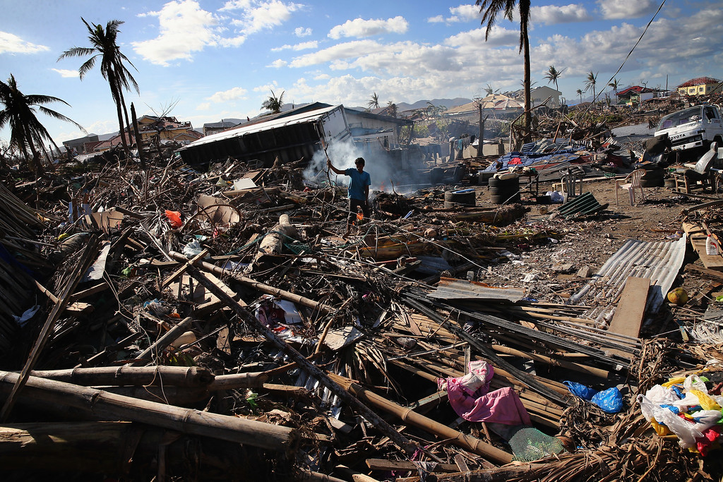 . A man sifts through debris on November 15, 2013 in Leyte, Philippines.  (Photo by Dan Kitwood/Getty Images)