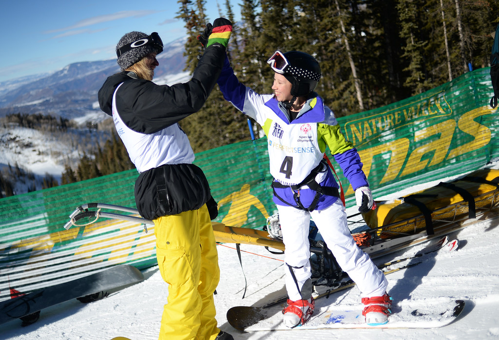 . Abe Teter, left, a coach 