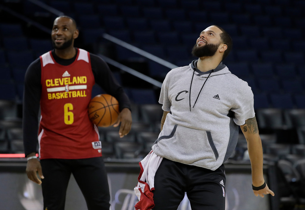 . Cleveland Cavaliers\' Deron Williams, right, follows through on a shot as teammate LeBron James watches during an NBA basketball practice, Wednesday, May 31, 2017, in Oakland, Calif. The Cavaliers face the Golden State Warriors in Game 1 of the NBA Finals on Thursday in Oakland. (AP Photo/Marcio Jose Sanchez)