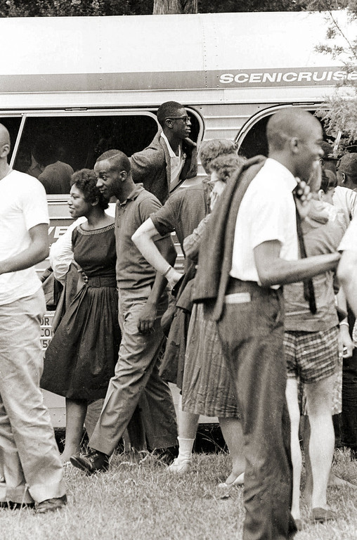 ". An unidentified ""Freedom Rider\"" sticks his head out of a chartered bus window in Jackson, Miss., having arrived from New York, Aug. 14, 1961. These black and white Riders challenged the rule of segregation by entering waiting rooms labeled \""colored\"" or \""White\"" thus testing a Supreme Court ruling banning racial segregation on interstate public transportation.  (AP Photo)"