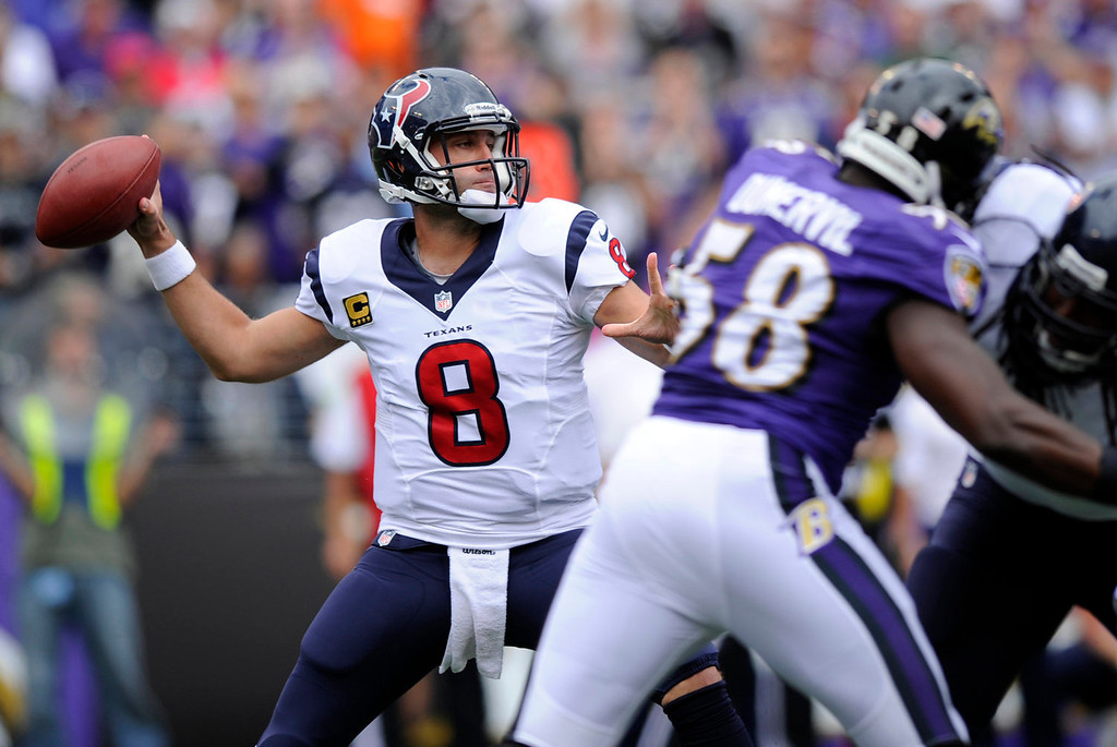 . Houston Texans quarterback Matt Schaub (8) throws to a receiver as he is pressured by Baltimore Ravens outside linebacker Elvis Dumervil (58) in the first half of an NFL football game Sunday, Sept. 22, 2013, in Baltimore. (AP Photo/Nick Wass)