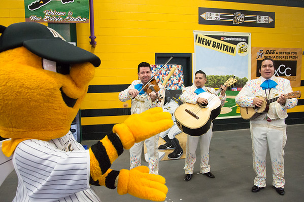 05/03/19 Wesley Bunnell | Staff The New Britain Bees home opener vs the Somerset Patriots on Friday night at New Britain Stadium. Mascot Sting makes the baby shark sign as the mariachi band from Cirque Du Soleil Luzia performs the song.