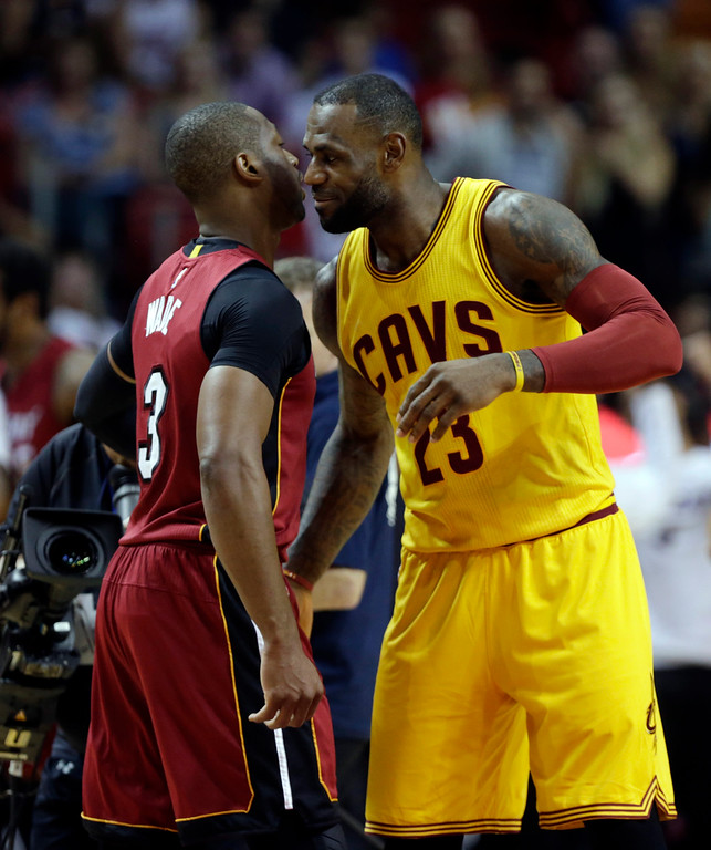 . Miami Heat guard Dwyane Wade (3) and Cleveland Cavaliers forward LeBron James (23) greet each other before an NBA basketball game, Saturday, March 19, 2016, in Miami. (AP Photo/Lynne Sladky)