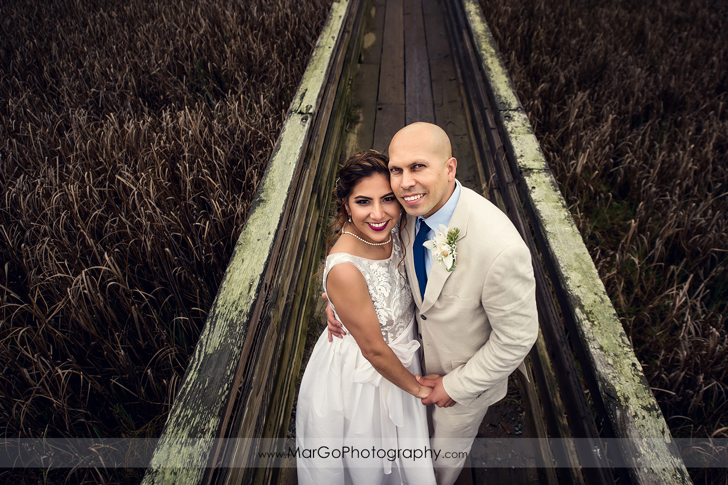 portrait of bride and groom on the bridge at Martinez Regional Shoreline