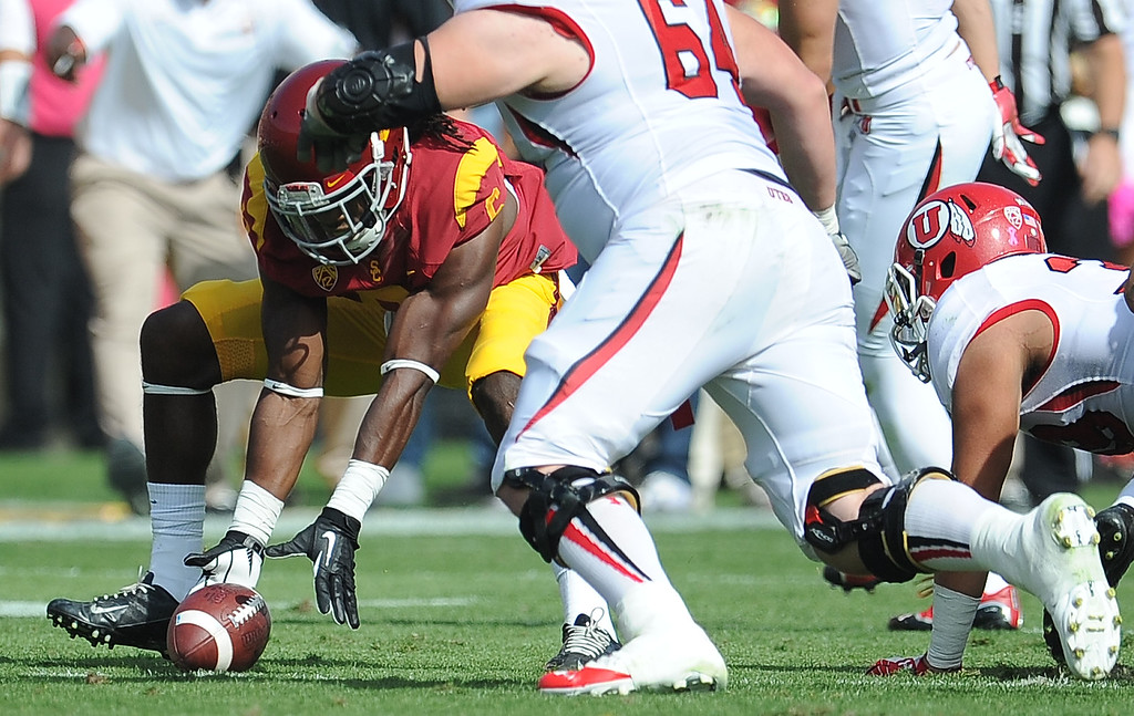 . Southern California safety Josh Shaw (6) recovers a Utah fumble during the first half of an NCAA college football game in the Los Angeles Memorial Coliseum in Los Angeles, on Saturday, Oct. 26, 2013.  (Photo by Keith Birmingham/Pasadena Star-News)