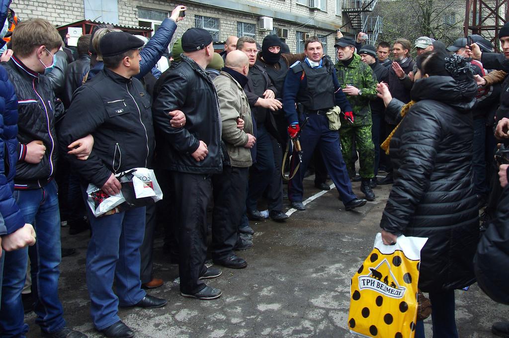 . Pro-Russia militiamen detain the head of the regional police after storming the regional police building in the eastern Ukrainian city of Horlivka (Gorlovka), near Donetsk, on April 14, 2014.   AFP PHOTO/ ALEXEY  KRAVTSOVALEXEY KRAVTSOV/AFP/Getty Images