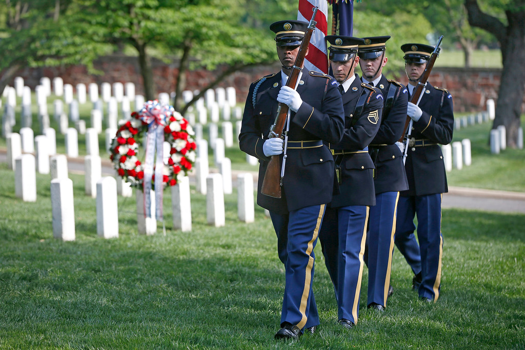 . U.S. Army honor guard members arrive at the gravesite of Army Pvt. William Christman, who was the first military burial at the cemetery, marking the beginning of commemorations of the 150th anniversary of Arlington National Cemetery in Arlington, Va., Tuesday, May 13, 2014. Christman, 20, enlisted in the 67th Pennsylvania Infantry and was hospitalized for measles five weeks later, dying on May 11, 1864 and buried at Arlington on May 13. (AP Photo)