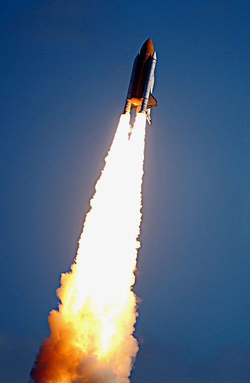 . The space shuttle Columbia begins her roll reversal during liftoff from the Kennedy Space Center on Jan. 16, 2003 in Cape Canaveral, Fla.  NASA managers are looking into a report that a piece of external tank insulation fell off during liftoff hitting the left hand side of the orbiter. Columbia and her crew of seven were lost during re-entry over Texas, Saturday Feb. 1, 2003. (AP Photo/NASA)