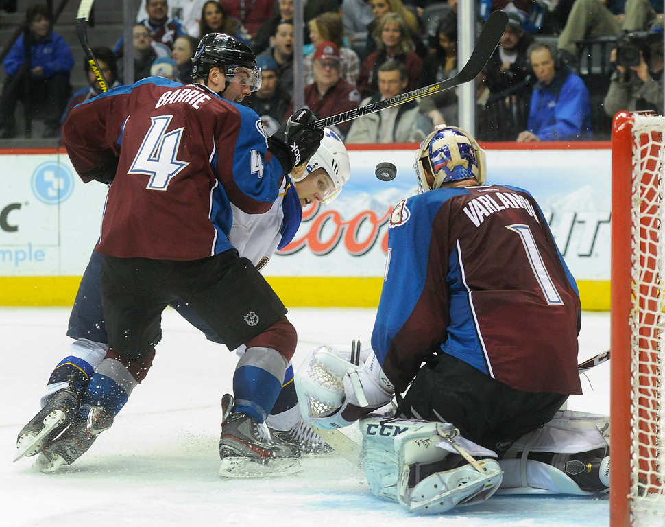 . St. Louis wing Vladimir Sobotka (17) tried to lift the puck past Colorado defender Tyson Barrie (4) and goalie Semyon Varlamov (1) in the second period.   Photo By Karl Gehring/The Denver Post