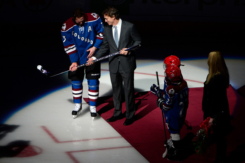 . DENVER, CO. - FEBRUARY 4: Avalanche legend Joe Sakic presents a silver stick to Milan Hejduk (23) of the Colorado Avalanche for his 1,000th career game before the first period of action. Colorado Avalanche versus the Dallas Stars at the Pepsi Center on February 4, 2012. (Photo By AAron Ontiveroz/The Denver Post)