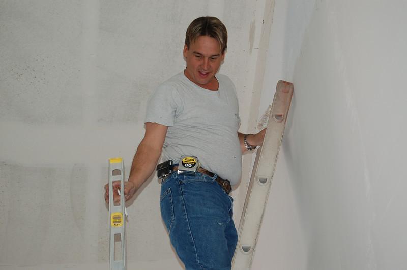Tom on a ladder.