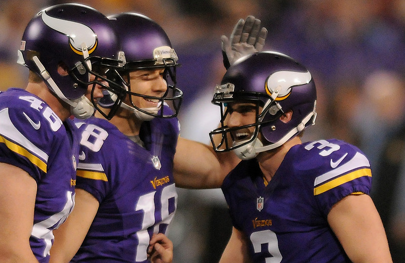 . Minnesota kicker Blair Walsh is congratulated by holder Jeff Locke and fullback Zach Line after kicking a 39-yard field goal in the fourth quarter. (Pioneer Press: John Autey)