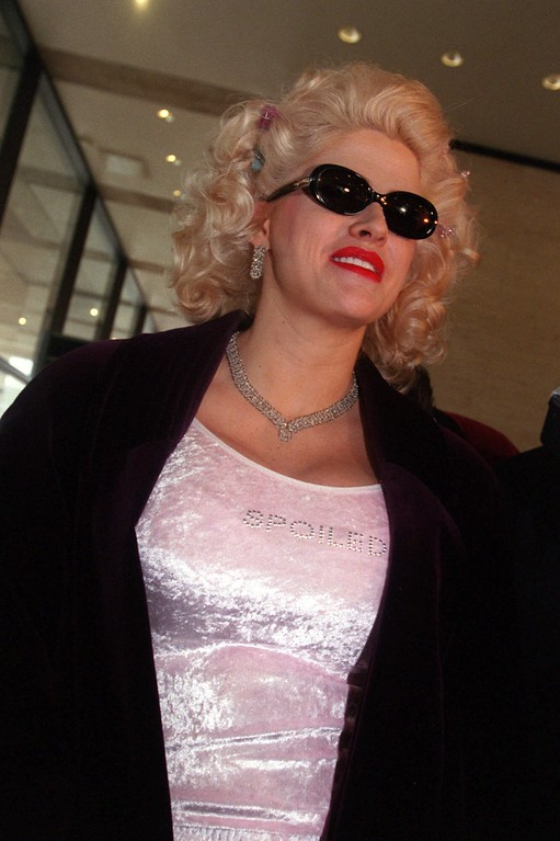 . Anna Nicole Smith, wearing a pale pink top with the word ``Spoiled\'\' beaded across it, leaves court after testifying in the probate trial of the estate of her late husband, J. Howard Marshall II, Wednesday, Feb. 14, 2001, in Houston. Smith completed her testimony in the trial over her late husband\'s oil fortune. (AP Photo/Carlos Antonio Rios, Pool)