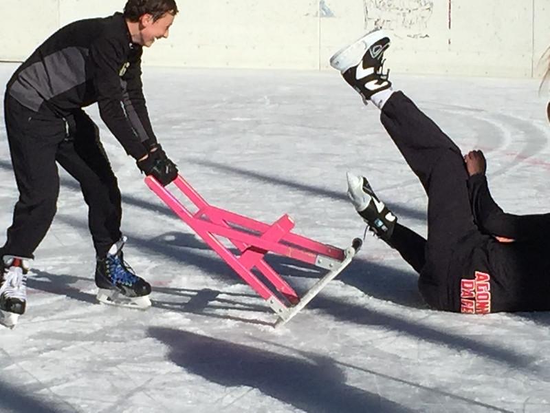 Ryan dumping Teddy on the ice