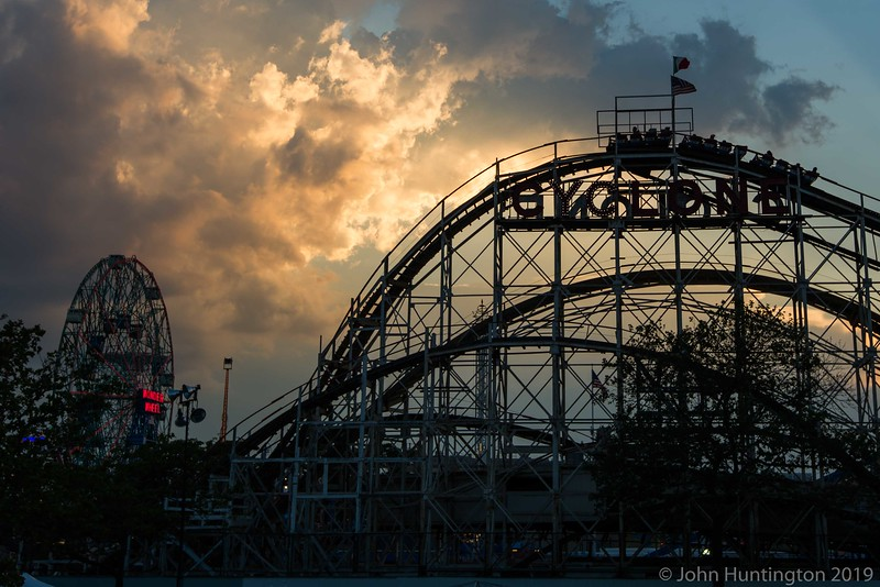 The Coney Island Cyclone roller coaster under a dramatic sky.