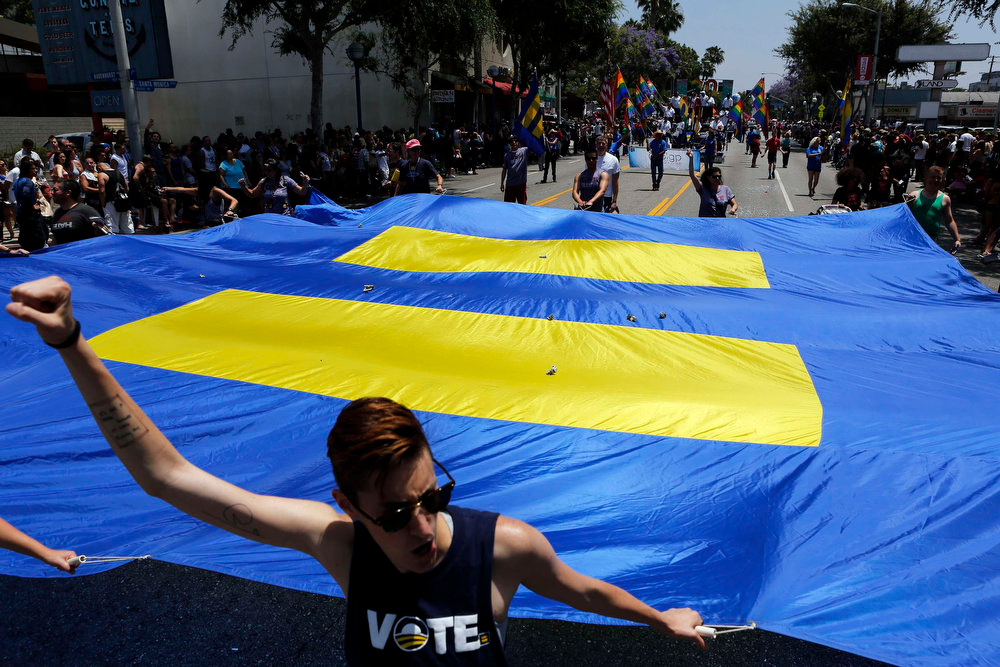 . Steph Mirsky walks in support of equality during the 43rd annual L.A. LGBT Pride Parade in West Hollywood June 9, 2013. The parade celebrates the lesbian, gay, bisexual and transgender communities in Los Angeles. REUTERS/Patrick T. Fallon