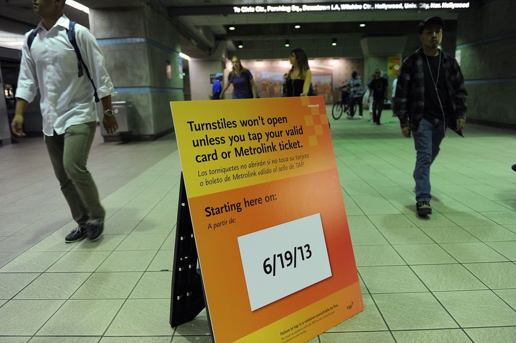 . A sign at the Union Station metro subway, Tuesday, June 18, 2013, warns the turnstiles will lock to those who don\'t purchase a TAP card or ticket. (Michael Owen Baker/Staff Photographer)