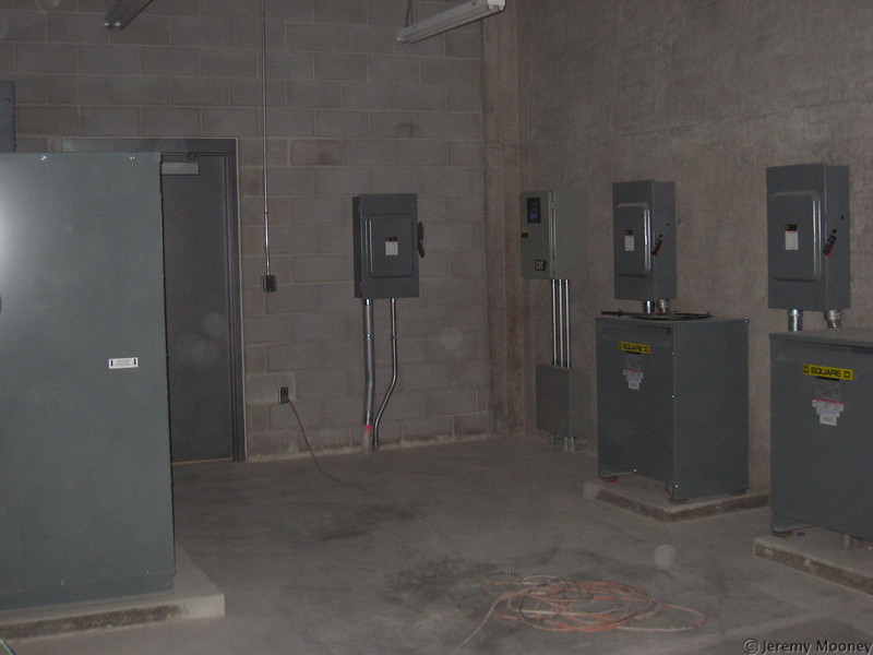 Electrical - Kitchen Transformer/panel on left, emergency transformers/transfer switch on right.